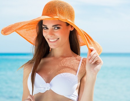 Happy Woman At Beach With White Bikini And Orange Hat